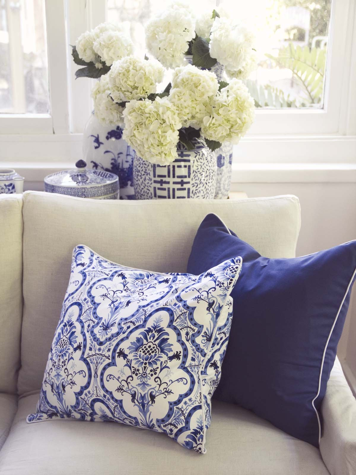 blue and white pillows. Black Bedroom Furniture Sets. Home Design Ideas